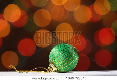 pict of a green xmas ball on bokeh background