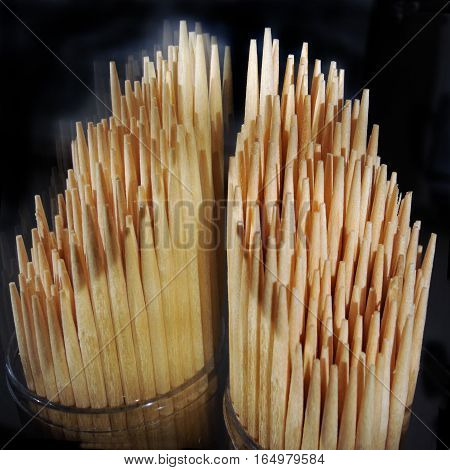 Wooden toothpicks, rhythm and texture, their reflection, close-up