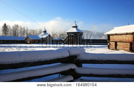 The fortress with towers and walls of the logs (17 century). Traditional Russian wooden architecture in Siberia. View winter. Taltsy. Irkutsk. Russia.