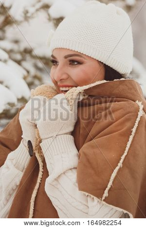 Beautiful woman outside wearing knit hat and jacket while looking forward. Selective focus, vintage toned image