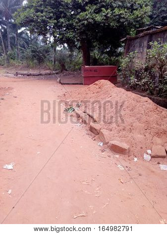 Image of a dusty pathway with sand heaps