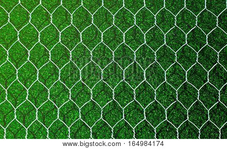 Earth retention wall with artificial grass, closeup view