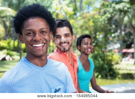 African american man with latin friends outdoor in the summer