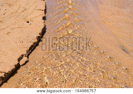 Water Flowing Over Sand Forming Intricate Pattern