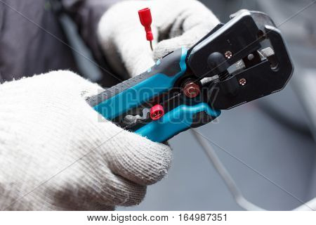 Hands of young electrician close up. Engineering profession.