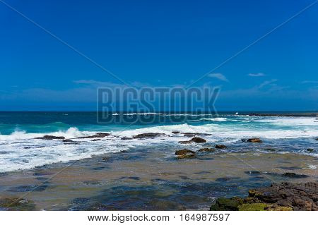 Blue Ocean Surface And Clear Sky. Summertime Vacation Background