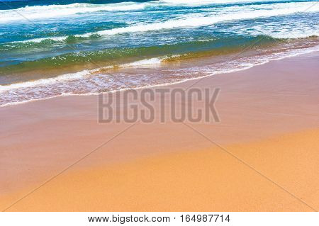 Soft Wave Of Blue Water On Sandy Beach. Seascape Background