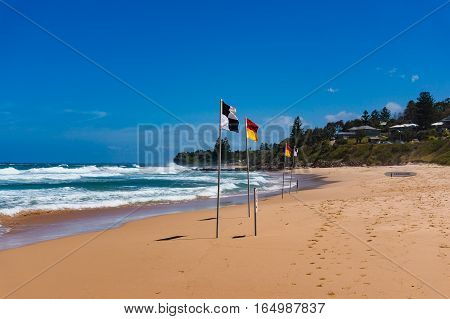 Beautiful Ocean Sandy Coastline With Beach Flags