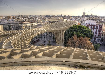 Views from footbridge over Metropol Parasol building Seville Spain. It provides a unique view of the old city center and the cathedral