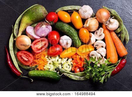 Fresh Vegetables On Dark Board