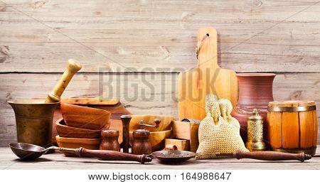 Various kitchen utensils on a wooden background