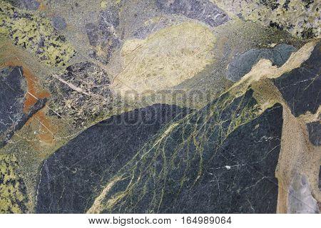 Mineral background. Breccia stone macro detail. Geology gemstone. Horizontal