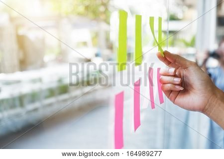 Sticky note paper reminder schedule board. Business people meeting and use post it notes to share idea on sticky note. Discussing - business teamwork brainstorming concept vintage tone.