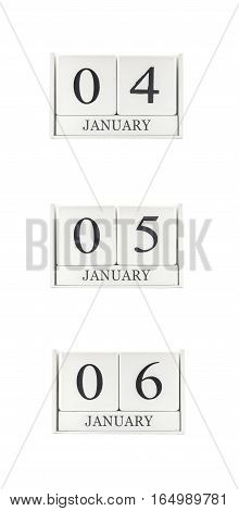 Closeup group of white wooden calendar with black 4 5 6 january word three date calendar isolated on white background