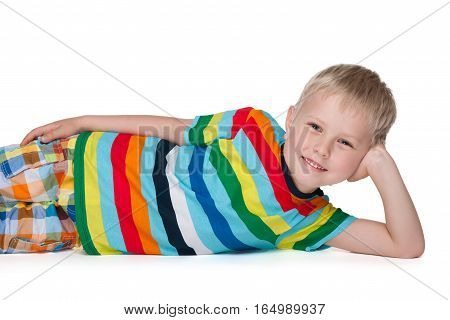 Little Blond Boy Rests On The Floor
