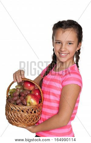 Young Girl Holds A Basket With Vegetables
