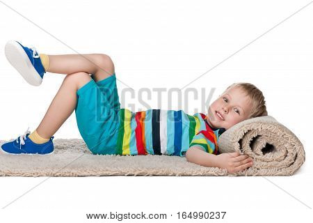 Cute Little Boy Rests On The Carpet