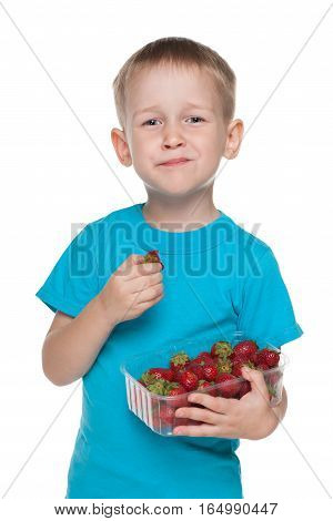 Little Boy Eats Strawberry