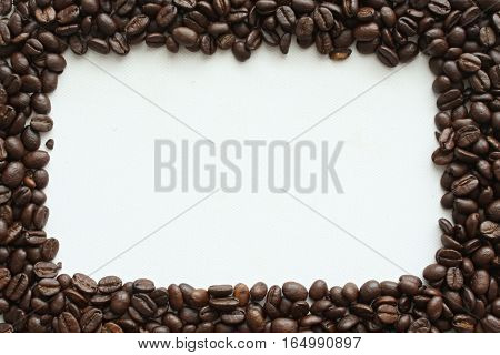 The frame of the roasted coffee on a white background.
