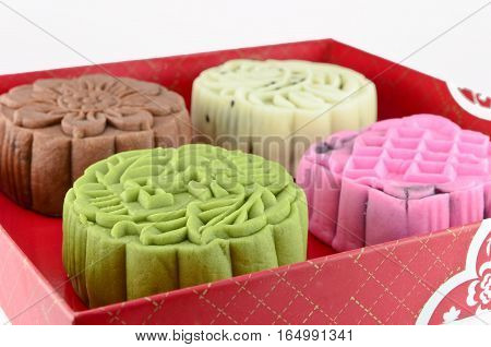 Colorful moon cake in red box isolated on white background