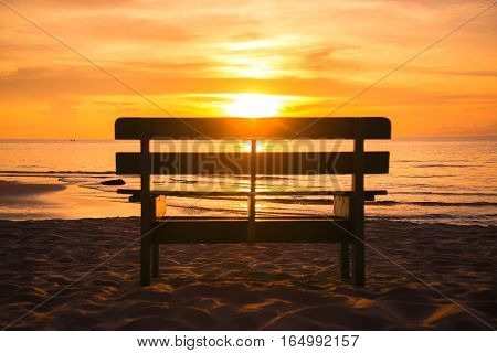 Blurred Sillouete chair and beautiful sunset as background