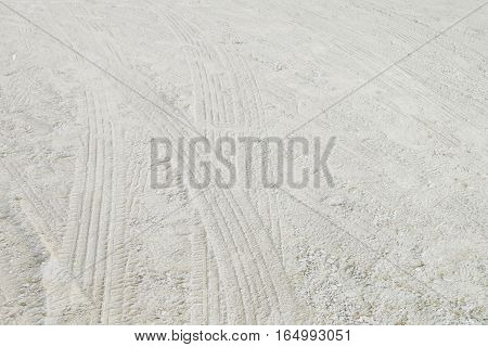 Closeup surface street floor in the countryside with tire tracks textured background
