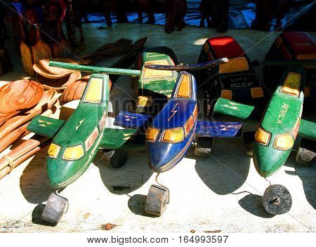 Hazyview, South Africa - April 25, 2014: African handmade toys helicopters planes and cars on the local craft market in the Hazyview South Africa. Modern tribal art.