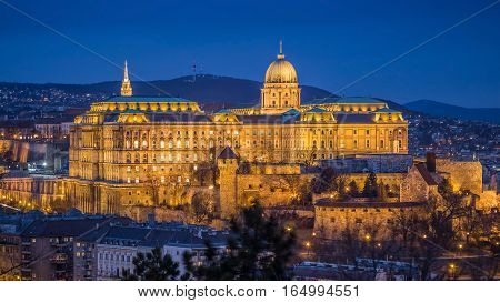 Budapest Hungary - The beautiful Buda Castle (Royal Palace) as seen from Gellert Hill illuminated in winter time at blue hour