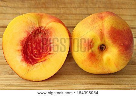 Fresh fruit peach on the wooden board.