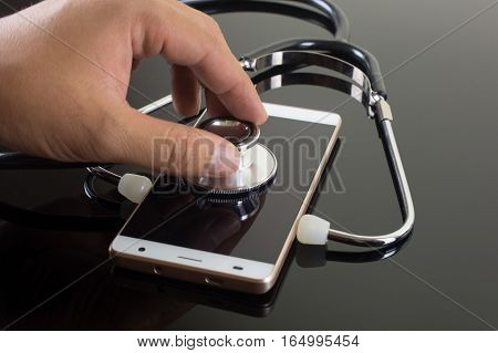 Hand Diagnose Smartphone Using Stethoscope Isolated On Black Background