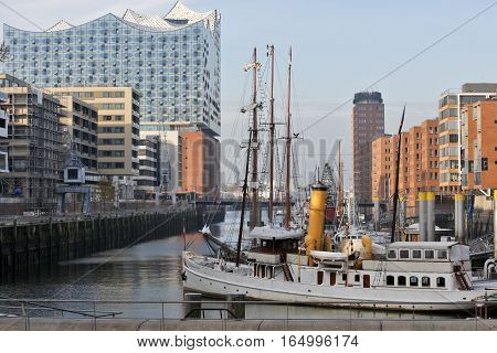 HAMBURG GERMANY - NOVEMBER 14: The Elbphilharmonie is a concert hall completed in 2016. The 110-meter high building stands prominently near the landing bridges on the Elbe in the west of HafenCity in Hamburg Germany on November 14 2016