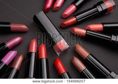 Set of color lipsticks studio shot on black background. Fashion colorful lipsticks. Professional make up and beauty.