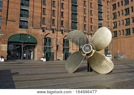 HAMBURG GERMANY - NOVEMBER 13: Big screw-propeller before The International Maritime Museum in Hamburg's Speicherstadt. Kaispeicher B building was redesigned and modernized in Hamburg Germany on November 13 2016
