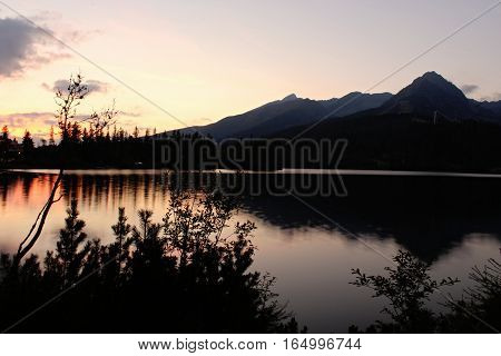 Sunset with the Lake and mountains in Hight Tatry.