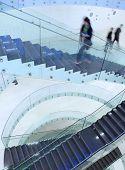 people inside a modern building (color toned image; motion blurred image) poster