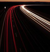 Night highway (Cars in a rush moving fast on a highway  (speedway) in the UK at the nightfall poster