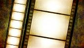 retro grunge background with film strips poster