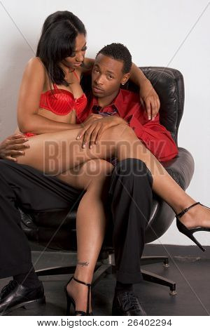Seductive woman of Creole ethnicity working with client, ethnic African-American businessman