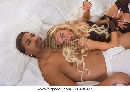 Playful sensual heterosexual couple - Caucasian woman and ethnic black man of mixed African-American and Italian ethnicity