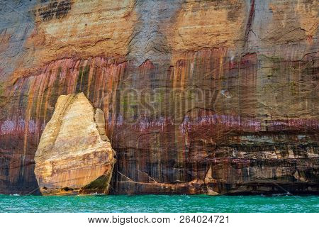 A Mitten Shaped Rocks Against The A Stone Cliff At Pictured Rocks National Lakeshore In Northern Mic