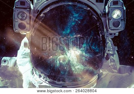 Dark Nebula And Stars In Space, Reflection On The Spacesuit Helmet. Adventure Of Spaceman. Astronaut