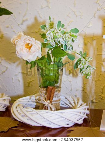a vase with colors standing in a white chaplet poster