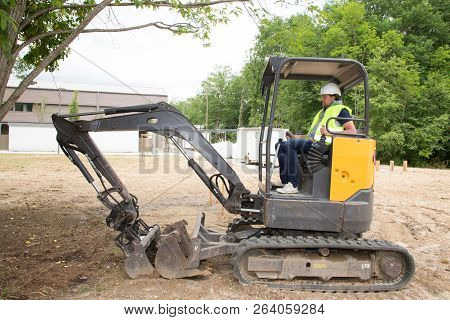 Big Excavator Loader Machine During Earthmoving Works Outdoors At Construction Site
