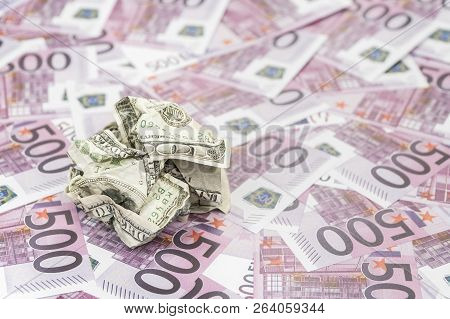 Crumpled Hundred Dollar Bill Against The Background Of Money In Denomination Of Five Hundred Euro