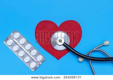 Medical, Medicine Stethoscope, Syringe, Injection And Pills On Blue Background. Health Care Or Illne
