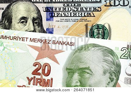A Close Up Image Of A Blue American One Hundred Dollar Bill With A Twenty Turkish Lira Bill
