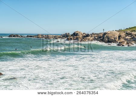 Cape Town, South Africa, August 9, 2018: Surfers At A Beach In Camps Bay In Cape Town In The Western