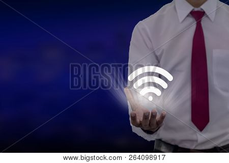 Young Businessman Study Of The Line Graph Of The Economic Growth Index On The Wifi 3d Screen.