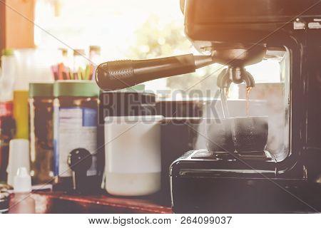 Preparing For Coffee By Coffee Machine Smoke Has Risen.