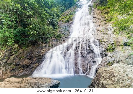 Waterfall Streams Flowing Over A Large Chunk Of Rock Has Many Ravines And Moss.thailand